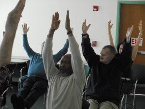 Betsy Davis from Bhakti Barn Yoga provides instruction on a seated pose